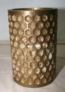 <b>Moule à bonbon circulaire en fonte, vers 1930.</b> Collection Viau, Écomusée du fier monde