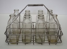 Eight-bottle metal basket, circa 1950. Montréal dairy heritage collection, Écomusée du fier monde