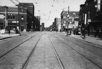 Eastward view of Ontario Street, near De Lorimier Stadium, to the left, circa 1930. City of Montreal Archives.